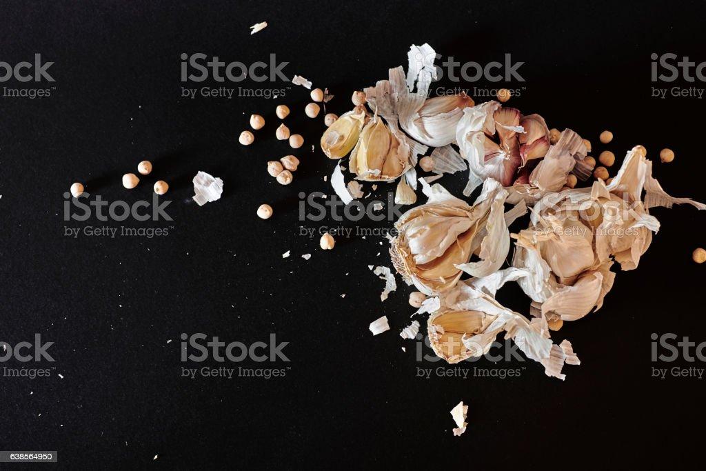 Garlic arrangement on black background stock photo