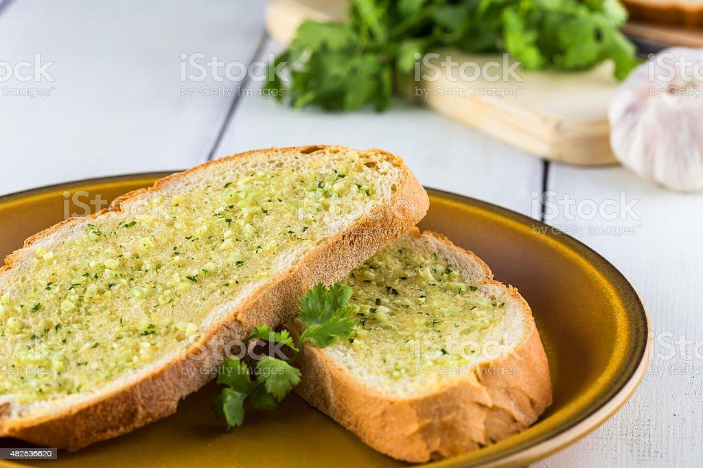 Garlic Bread on Rustic White Table stock photo