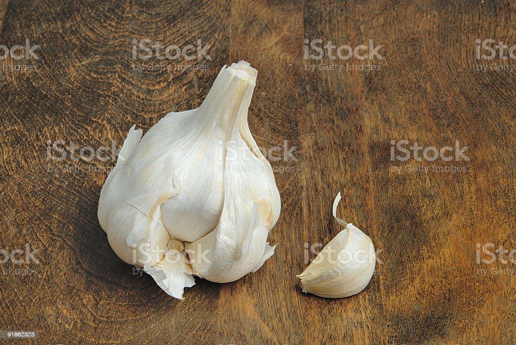 Garlic bulb and clove royalty-free stock photo