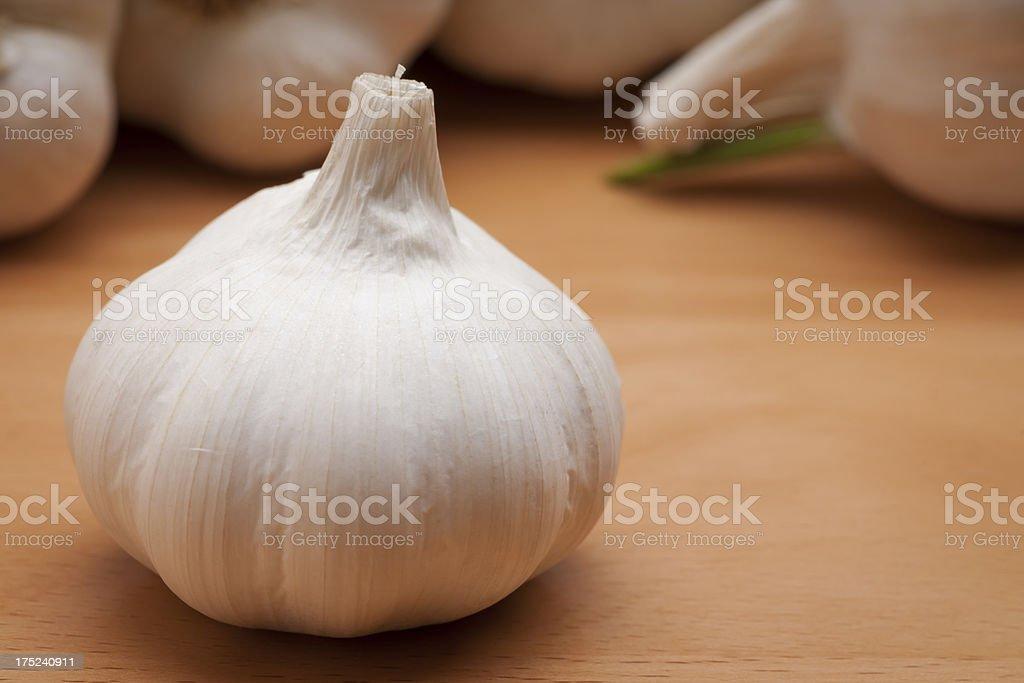 Garlic Bulb on Wood Horizontal stock photo