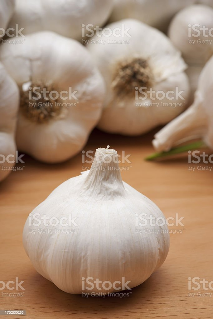Garlic Bulb on Wood Vertical royalty-free stock photo