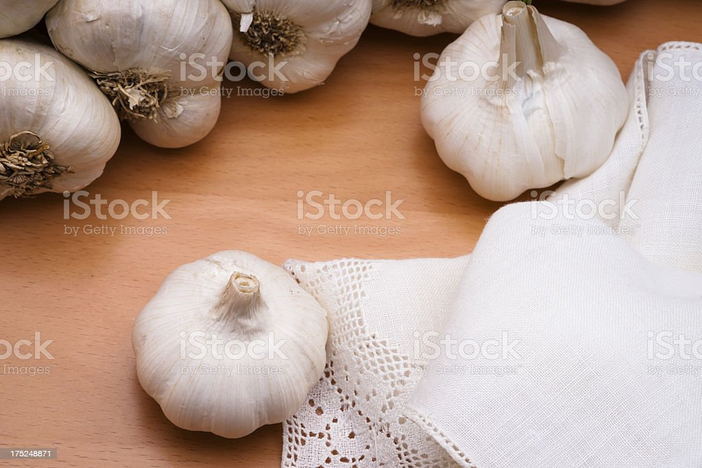 Garlic Bulb with Napkin on Wood Horizontal stock photo