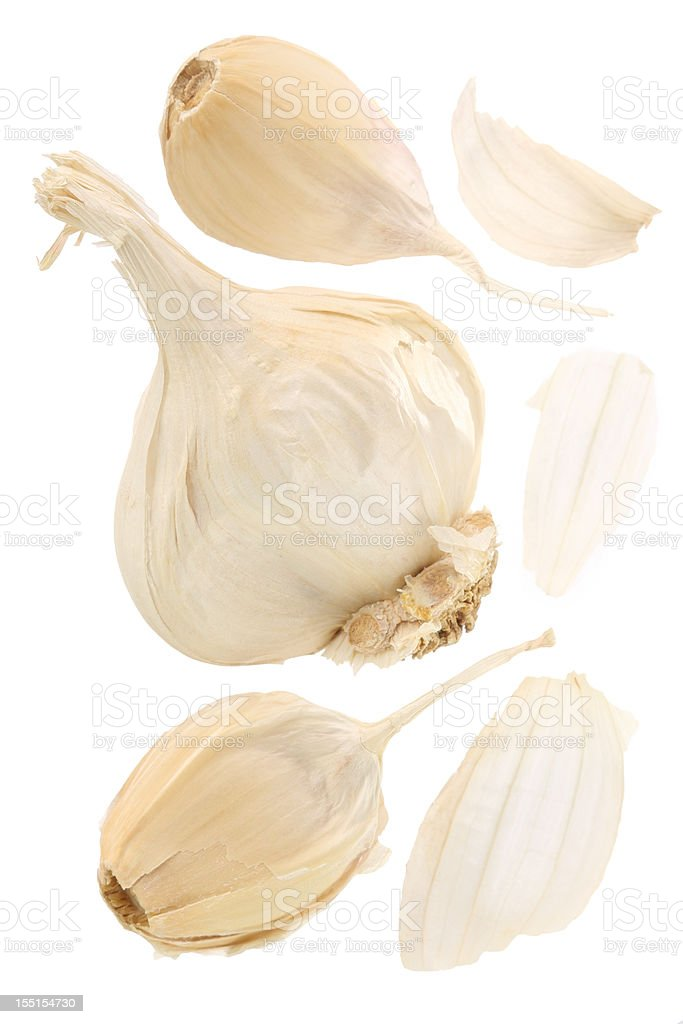 Garlic bulb with split away cloves on a white background stock photo