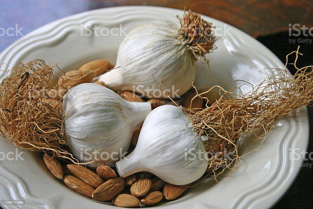 Garlic Bulbs and Raw Almonds royalty-free stock photo