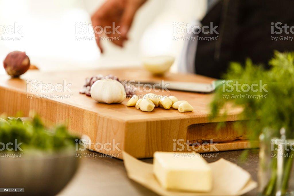Garlic cloves on cutting board stock photo