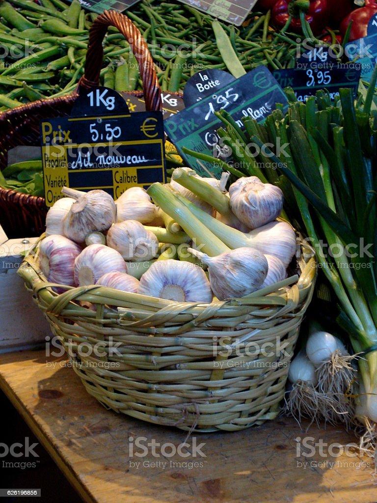 Garlic in Basket at market stand stock photo