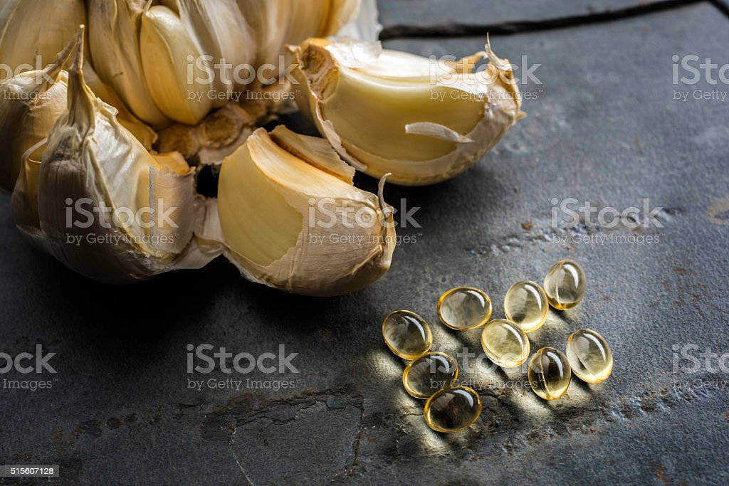 Garlic Oil capsules stock photo
