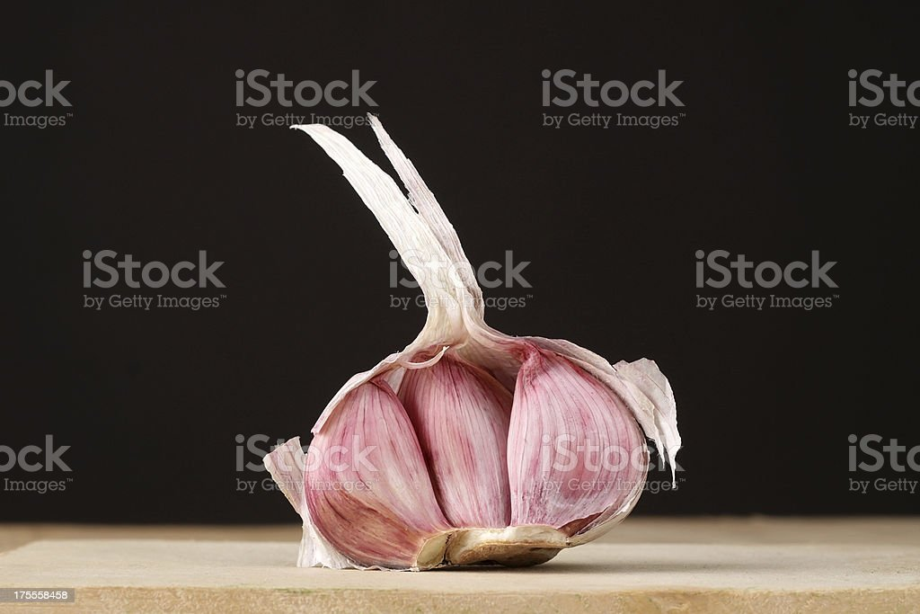 Garlic on a wooden table royalty-free stock photo