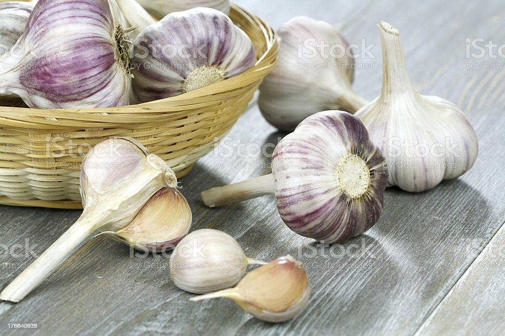 Garlic on a wooden table stock photo