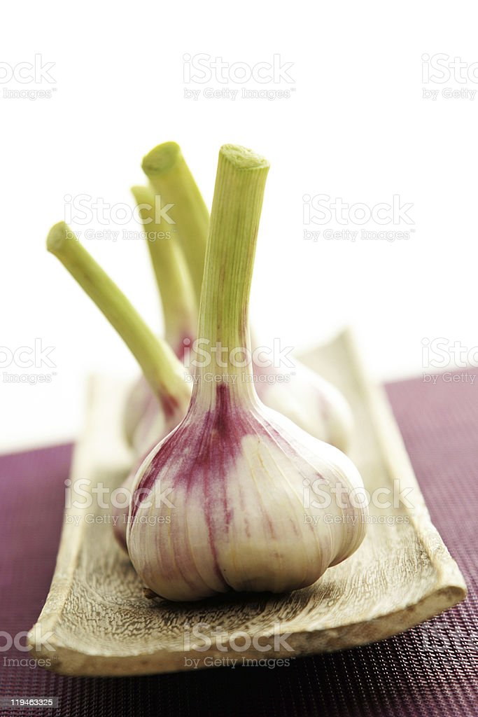garlic on a wooden tray stock photo