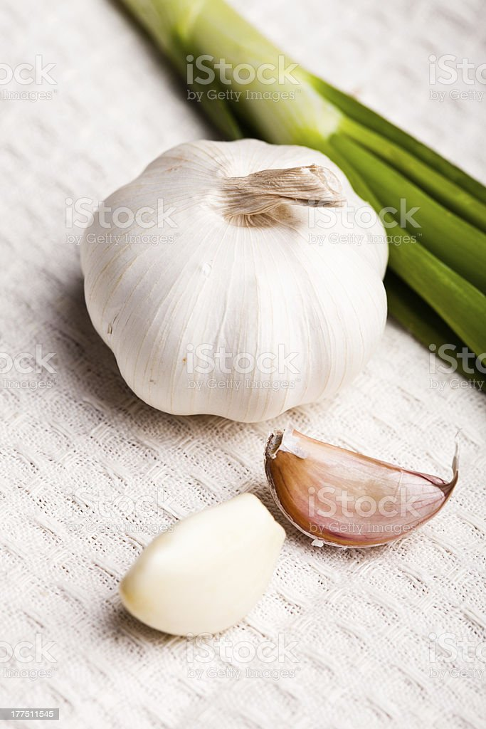 Garlic on tablecloth royalty-free stock photo