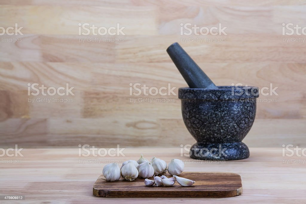 Garlic on the wooden background royalty-free stock photo