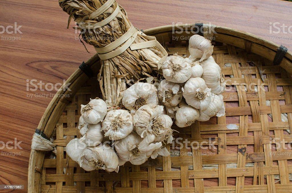 Garlic on wood stock photo