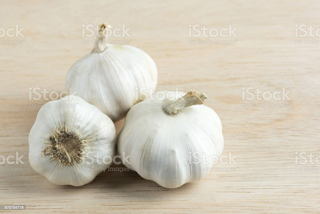 Garlic on wooden cutting boards. stock photo