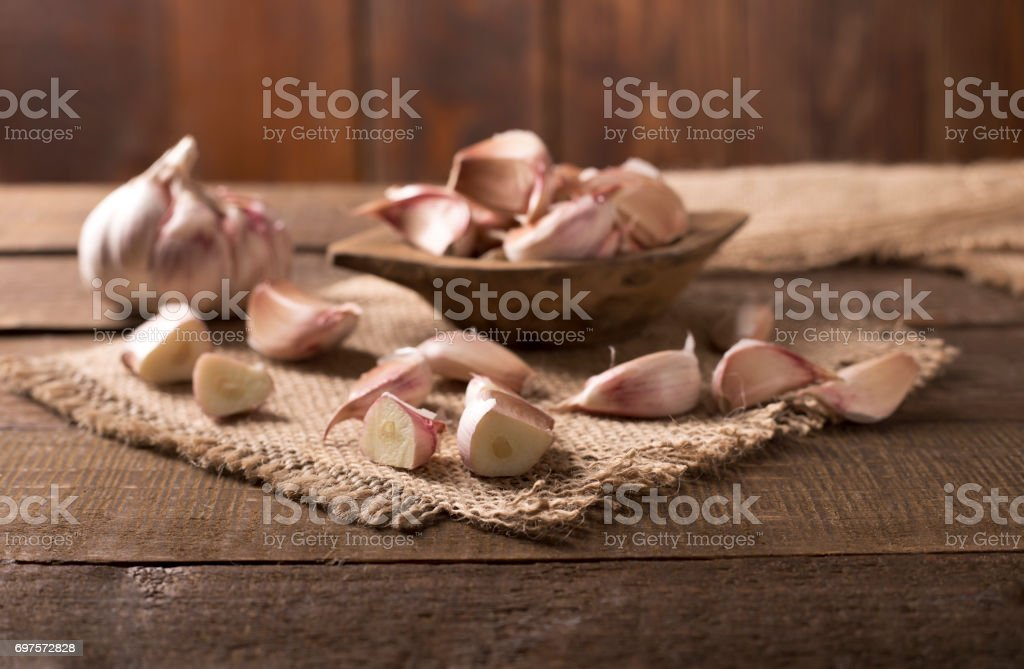 garlic on wooden table stock photo