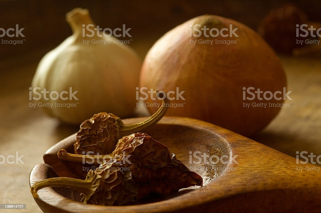 Garlic, onion, dried peppers royalty-free stock photo
