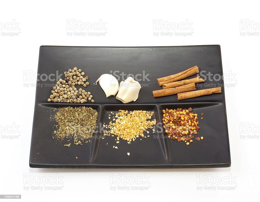 Garlic, oregano, cinnamon and pepper seeds royalty-free stock photo
