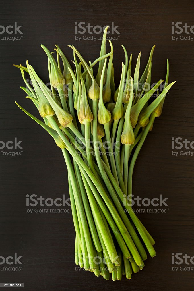 Garlic Scapes on Black stock photo