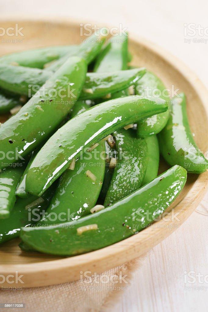 garlic snap pea stock photo