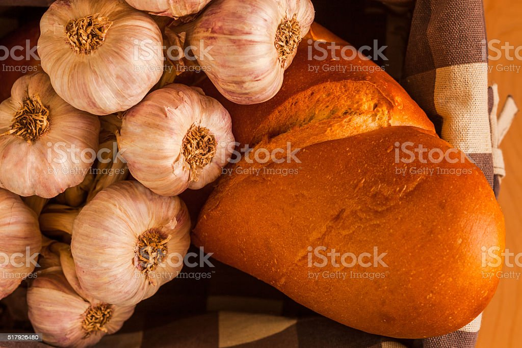 Garlic String with bread in cloth lined basket (P) stock photo