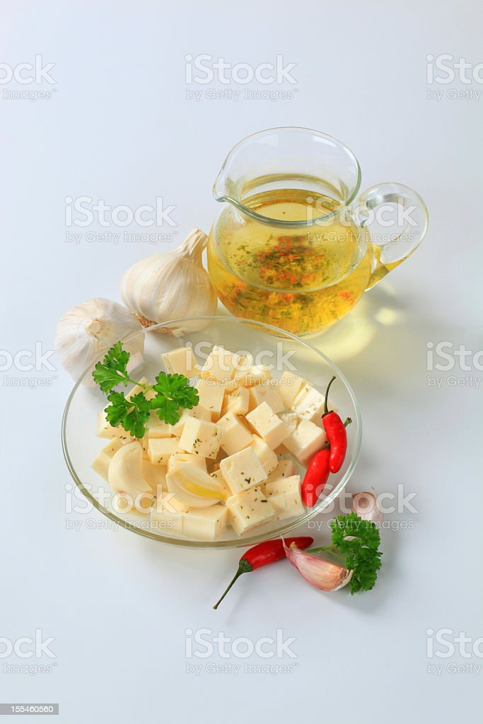 Garlic with oil and cheese stock photo