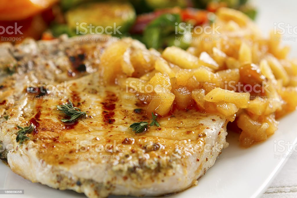Garlic-herbed Pork Chops with Applesauce stock photo