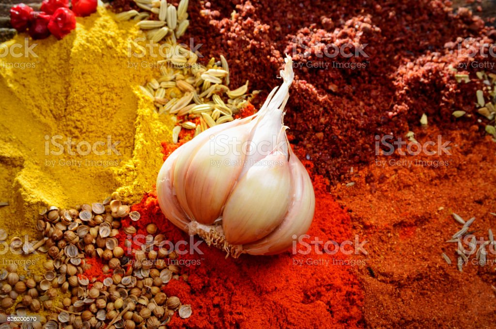 Garlic,spices mix on a wooden background stock photo