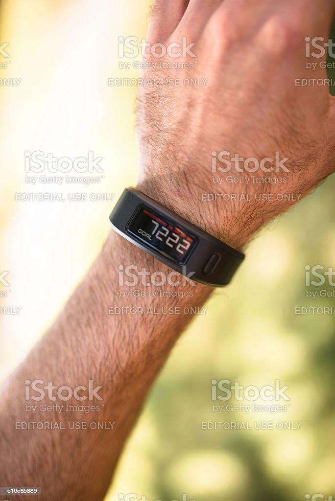 Garmin vivofit, sport fitness tracker and clock stock photo