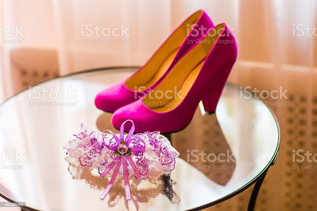 garter and wedding shoes stock photo