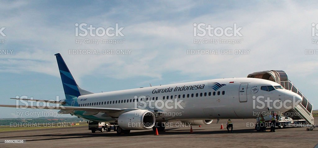 Garuda Indonesia Airplane Parked At Airport In Bali Indonesia stock photo