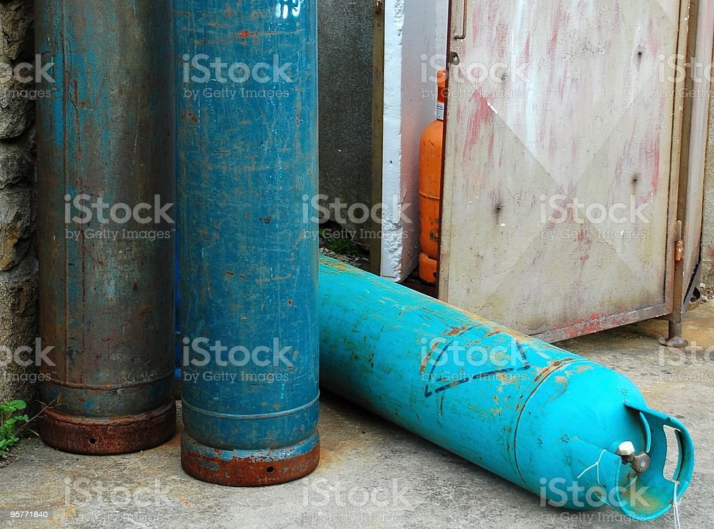Gas bottles messed up royalty-free stock photo