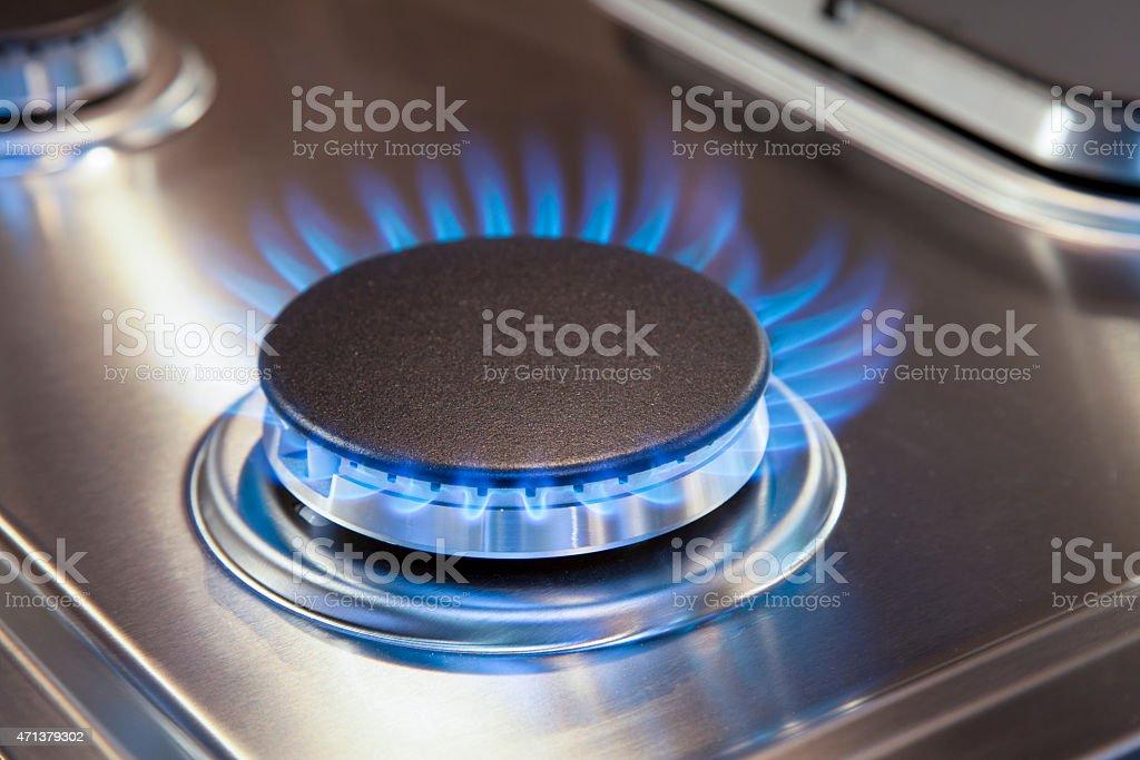 Gas burner on stove stock photo
