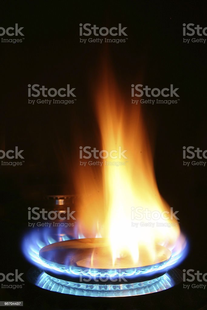 Gas Burner with blue and orange flames stock photo