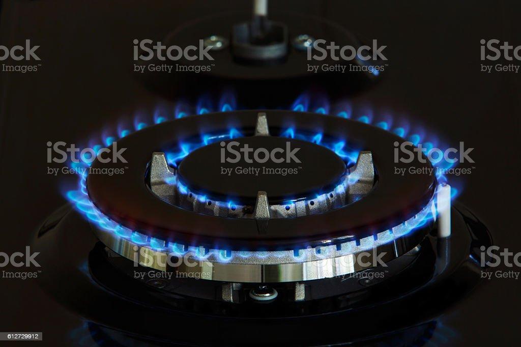 gas burners lit stock photo