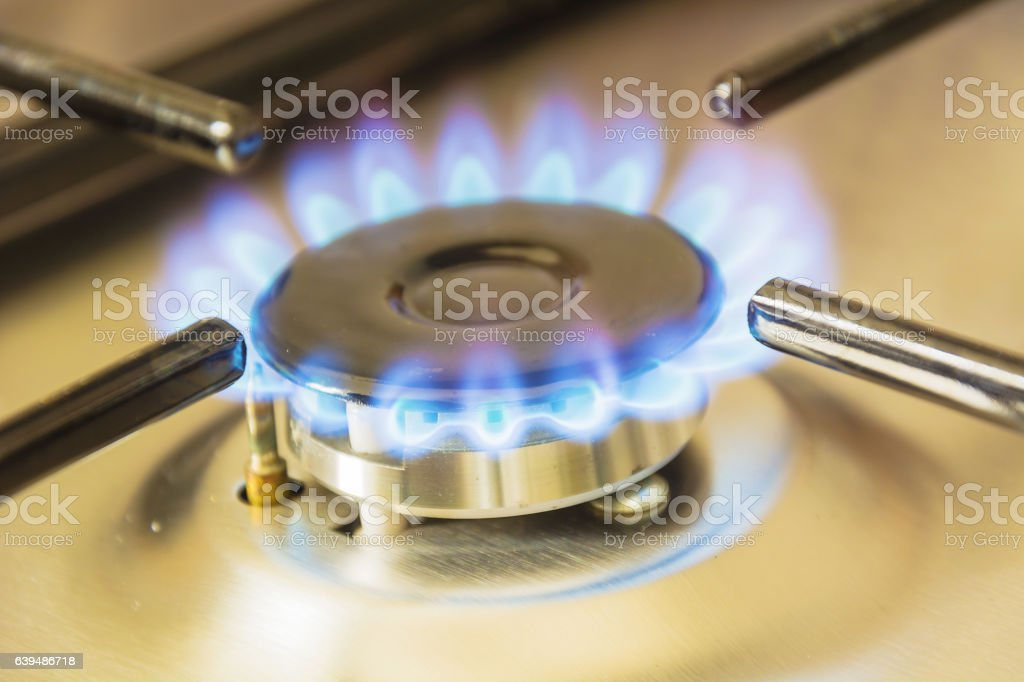 gas burning from a stove stock photo