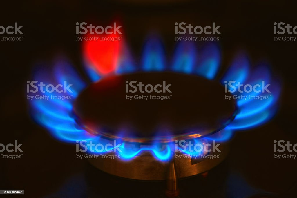 Gas burning on the stove stock photo