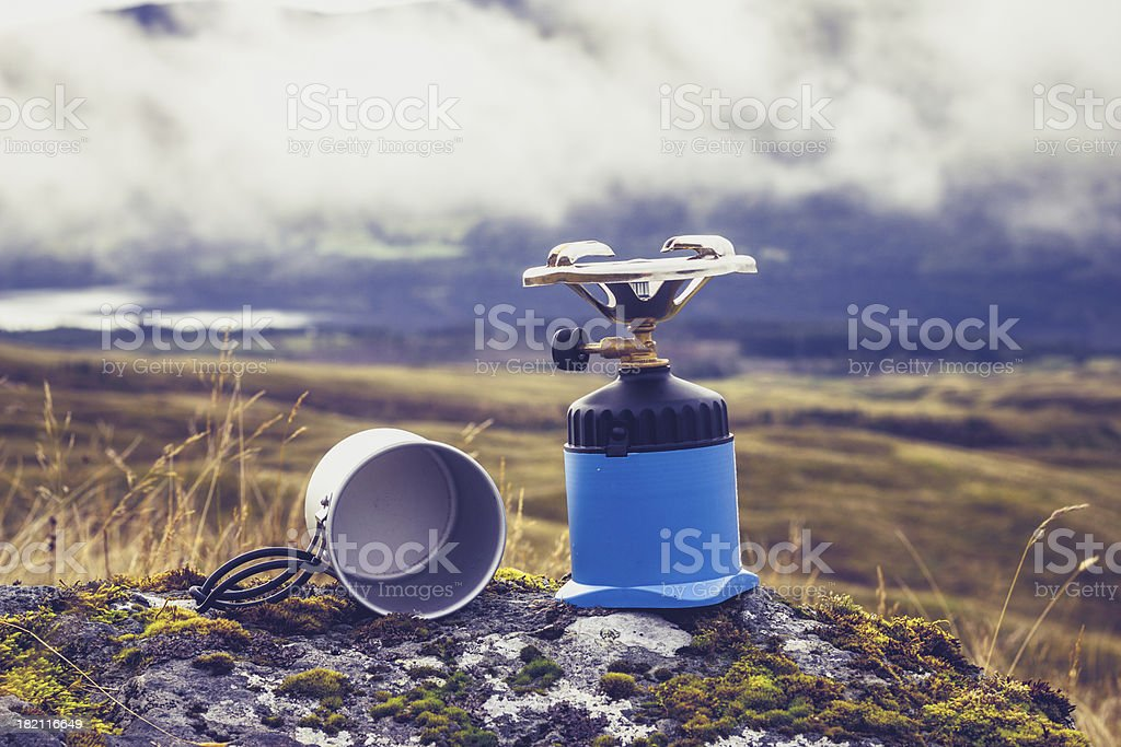 Gas camping stove and pot in the mountains royalty-free stock photo