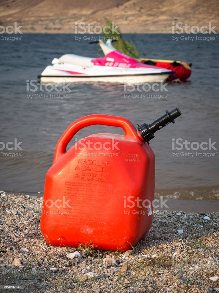 Gas Can with Jet-ski in Background stock photo