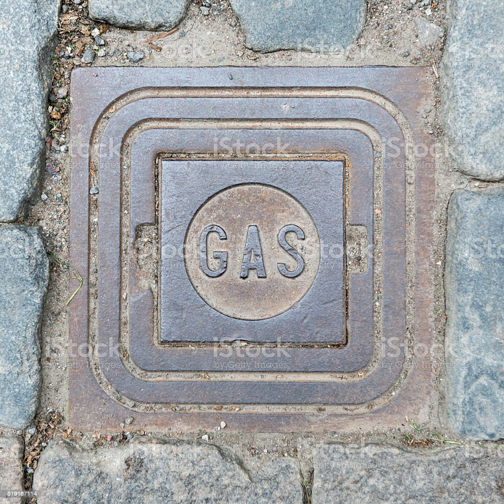 Gas cover on cobblestone road in Stockholm, Sweden stock photo