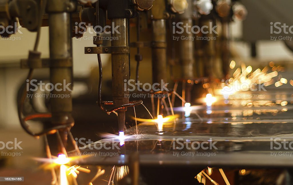 CNC LPG gas cutting close-up with water cooling royalty-free stock photo