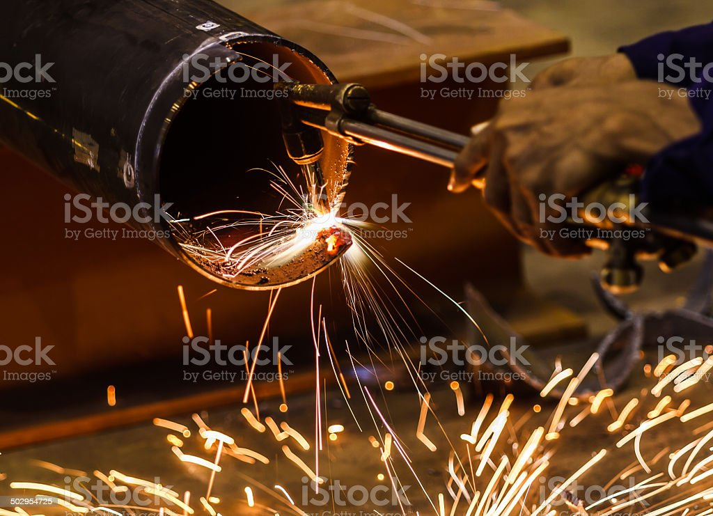 Gas cutting of the metal with sparks close up royalty-free stock photo