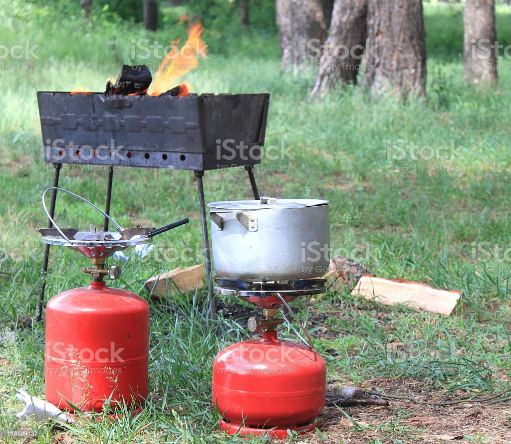 Gas cylinder and BBQ for cooking stock photo