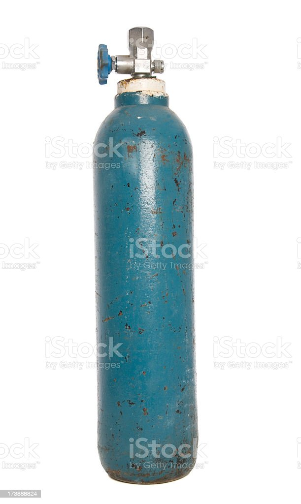 Gas cylinder tank with rust spots and peeling blue paint stock photo