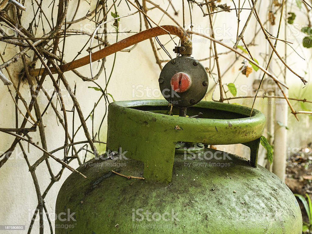 Gas cylinder with weathered house connection. Safety. Paraguay, stock photo