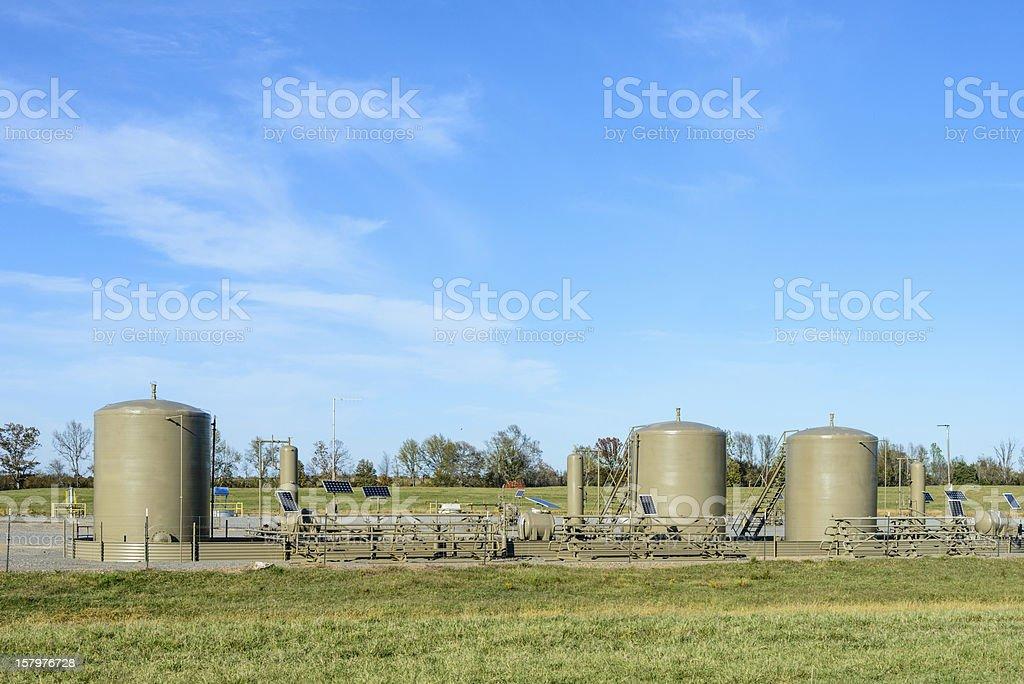 Gas field storage tanks stock photo