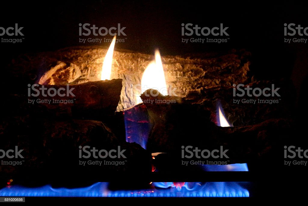 Gas Fire in Fireplace with Blue Flame stock photo