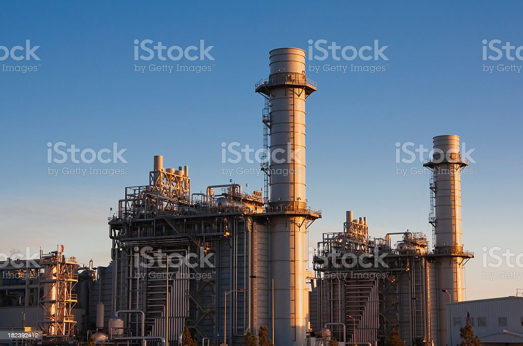 Gas fired turbine power plant with blue sky background royalty-free stock photo