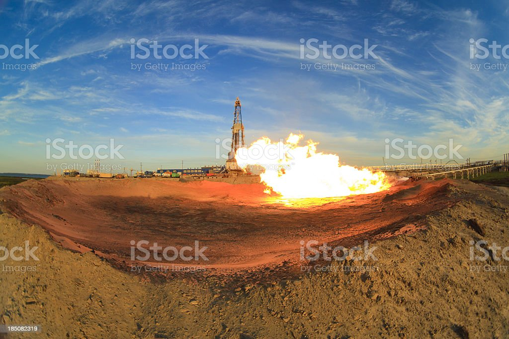 Gas flame in front of oil rig (Russia) royalty-free stock photo