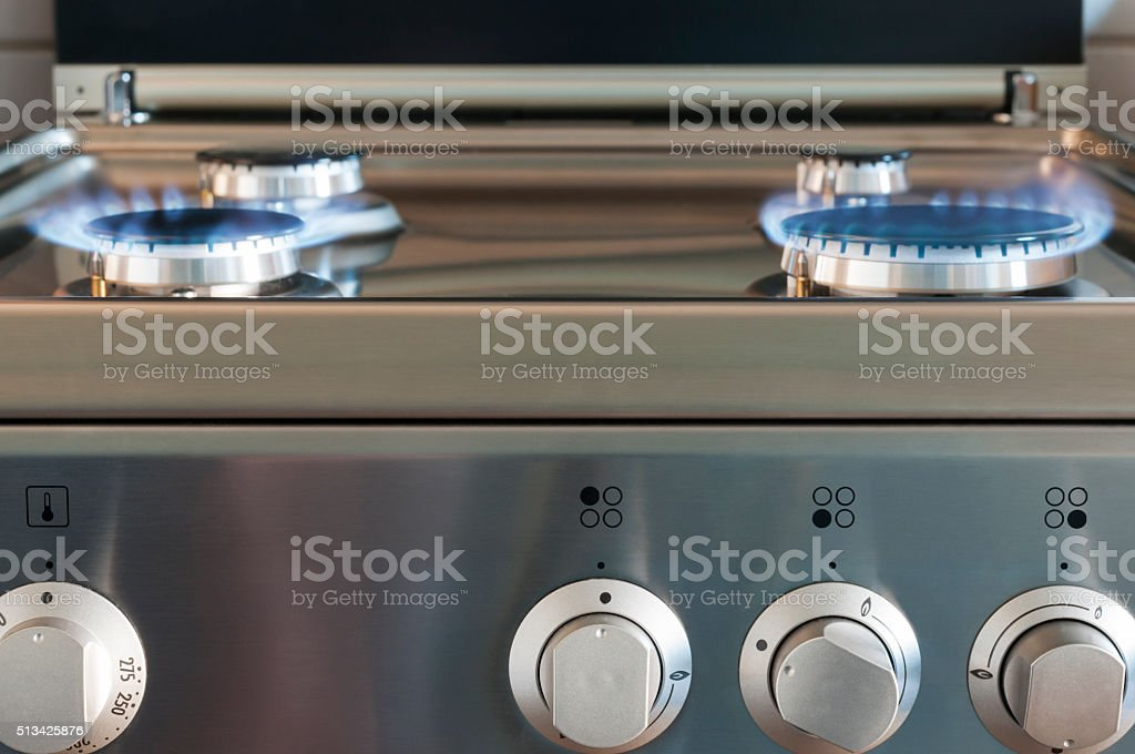 Gas flame of a gas stove stock photo
