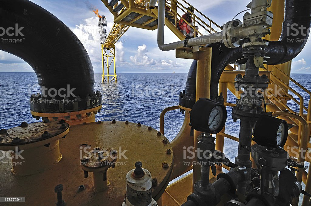 gas flare is on the oil rig platform royalty-free stock photo